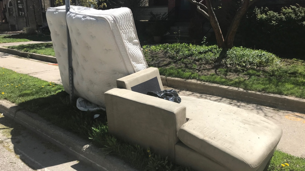 A mattress and chaise put to the curb