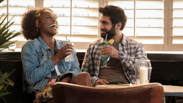 "This image released by Netflix shows Issa Rae as Leilani, left, and Kumail Nanjiana as Jibran in a scene from ""The Lovebirds."" (Skip Bolen/Netflix via AP)"