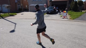 Toronto teacher Charles Minor runs through his community in support of the Agincourt Food Bank.