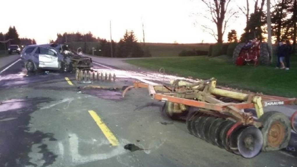 SUV crashes into farm tractor