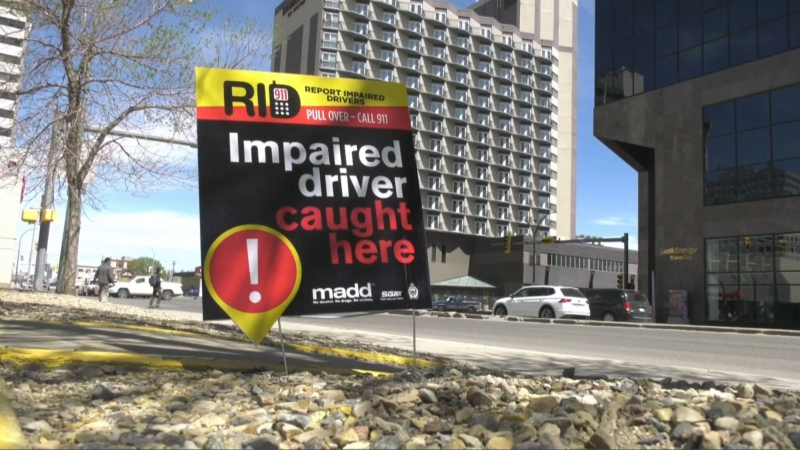 Signs reminding people to report impaired drivers