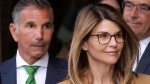 FILE - In this April 3, 2019, file photo, actress Lori Loughlin, front, and her husband, clothing designer Mossimo Giannulli, left, depart federal court in Boston after a hearing in a nationwide college admissions bribery scandal. (AP / Steven Senne, File)