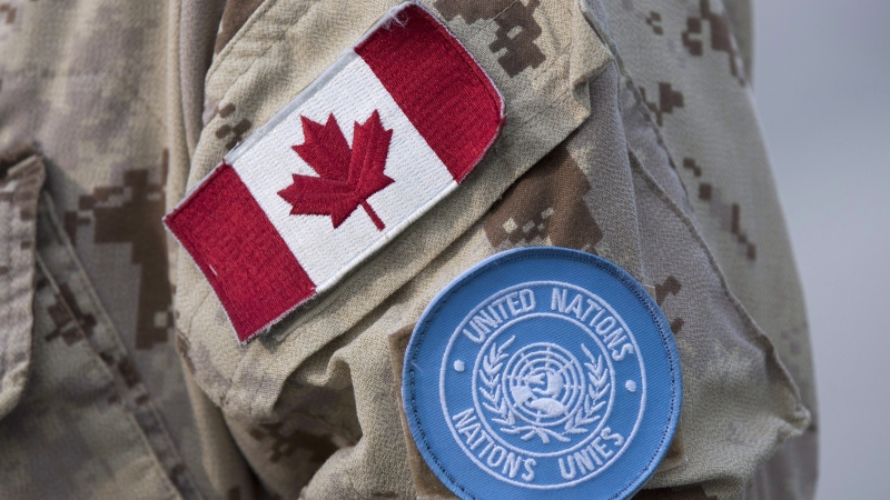 Canadian flag and the UN flag is shown on the sleeve of a Canadian soldier's uniform before boarding a plane at CFB Trenton in Trenton, Ont., on July 5, 2018. THE CANADIAN PRESS/Lars Hagberg