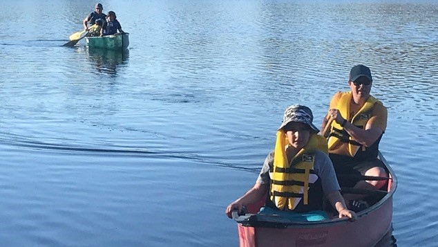Phil Leblanc and his son, Nate, canoe with friends on the Pond Mills Pond on Thursday, May 21, 2020 (Sean Irvine CTV London)