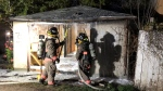Saskatoon Fire Department responds to a boarded-up garage on fire in the 100 block of Avenue K South on May 22, 2020.