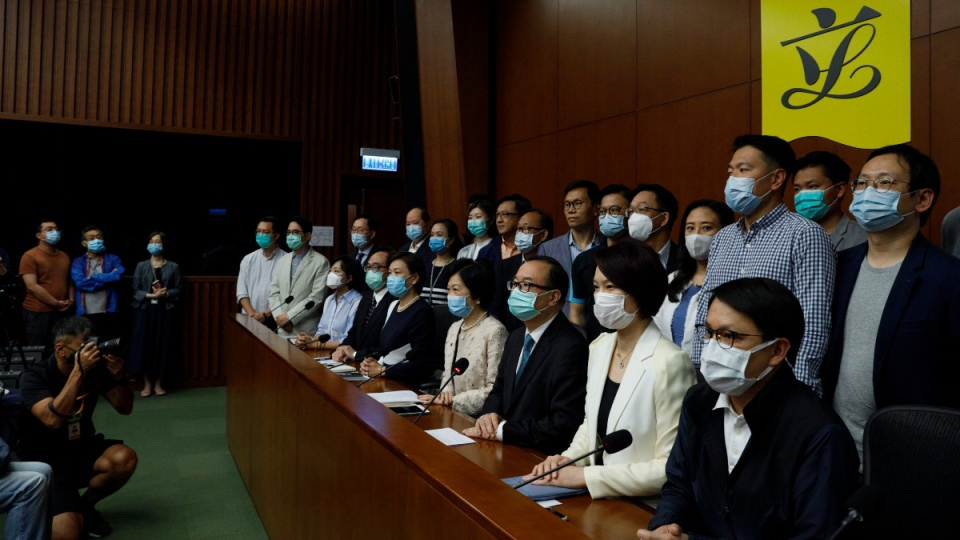 Pro-China lawmakers attend a press conference