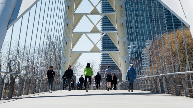 People get exercise outside on the lake shore path along Lake Ontario in Toronto on Thursday, April 2, 2020. THE CANADIAN PRESS/Nathan Denette