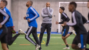 In this Jan. 14, 2020, file photo, Montreal Impact coach Thierry Henry, center, conducts his first practice with the MLS soccer team in Montreal. (Ryan Remiorz/The Canadian Press via AP, File)