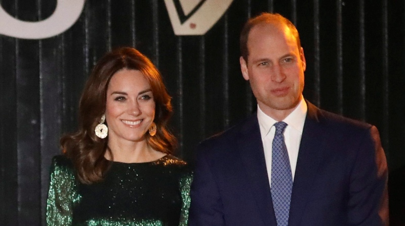 Prince William and Kate, Duchess of Cambridge pose for photographers during a visit to the Guinness Storehouse in Dublin, Tuesday, March 3, 2020. (AP Photo/Peter Morrison)