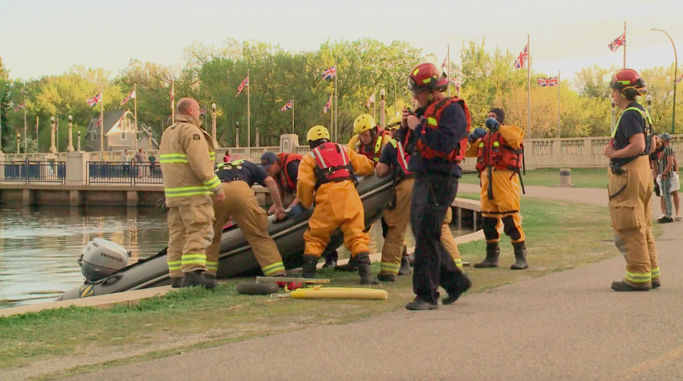 Water rescue crews prepare to search for a body in Wascana Lake on May 21, 2020