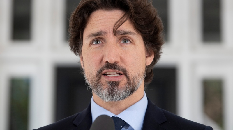 Prime Minister Justin Trudeau responds to a question from the media during a daily news conference outside Rideau Cottage in Ottawa, Friday May 22, 2020. THE CANADIAN PRESS/Adrian Wyld