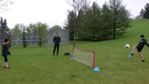 Cenek Patik and his two sons practice soccer drills at Deerfoot Athletic Park. He says he was handed a ticket from a police officer for holding the practice over the weekend.