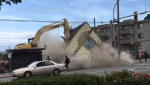 An Esquimalt building's final moments were caught on camera Friday: (Leah DeForrest)