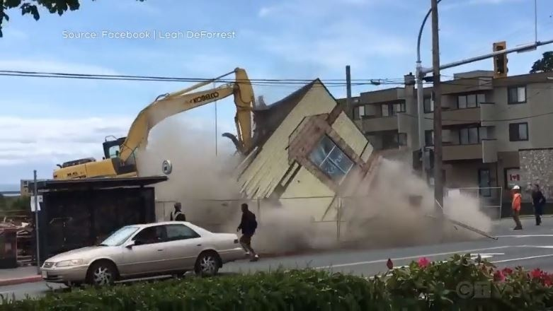 An Esquimalt building's final moments were caught on camera Friday: (Leah DeForrest)