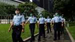 Police officers patrol outside the Central Government Offices in Hong Kong, Friday, May 22, 2020. (AP / Kin Cheung)