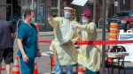 Health-care workers prepare to open a mobile COVID-19 testing clinic, Tuesday May 19, 2020 in Montreal.THE CANADIAN PRESS/Ryan Remiorz