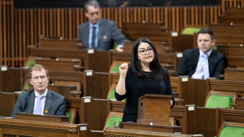 Women and Gender Equality and Rural Economic Development Minister Maryam Monsef demonstrates a sign to use to raise awareness as she speaks during a meeting of the Special Committee on Covid-19 Pandemic in the House of Commons in Ottawa, Wednesday, May 20, 2020. THE CANADIAN PRESS/Adrian Wyld