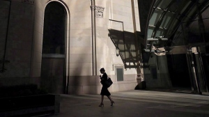 A woman walks through Toronto's financial district on July 30, 2018. THE CANADIAN PRESS/Graeme Roy