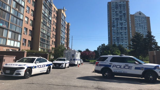 Police vehicles are shown at the scene of a suspicious death investigation in the Glenn Hawthorne Boulevard and Hurontario Street area of Mississauga on Saturday. (Shanelle Kaul)