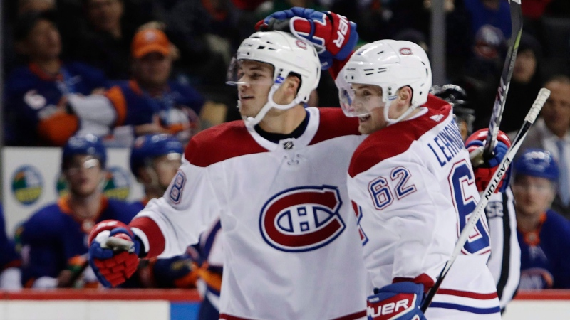 Montreal Canadiens' Artturi Lehkonen, right, celebrates with Noah Juulsen after Juulsen scored a goal during the third period of an NHL hockey game against the New York Islanders on Friday, March 2, 2018, in New York. THE CANADIAN PRESS/AP-Frank Franklin II