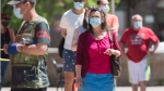 People wait to be tested for COVID-19 at a mobile testing clinic in the Montreal neighbourhood of Verdun, Saturday, May 23, 2020, as the COVID-19 pandemic continues in Canada and around the world. THE CANADIAN PRESS/Graham Hughes