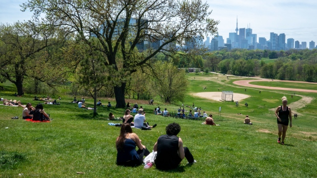 Park visitors soak up the sun in Toronto on Saturday, May 23, 2020. (THE CANADIAN PRESS / Frank Gunn)