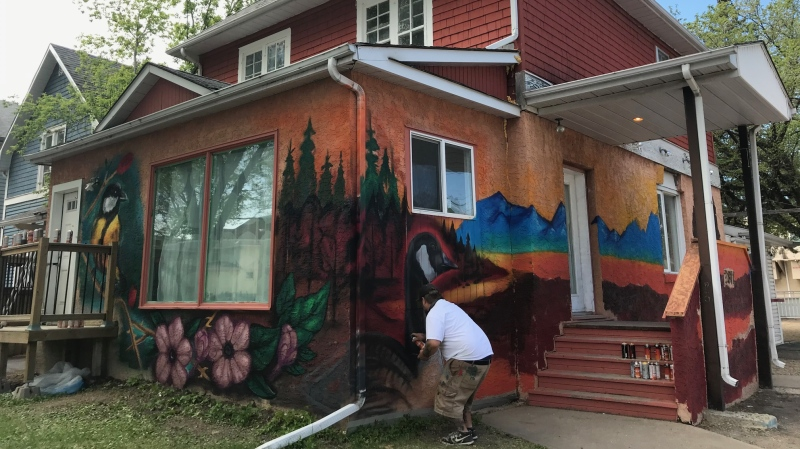 Josh Goff paints a mural for the 29th  Cathedral Village Arts Festival. The annual festival was forced into an online format in 2020 due to COVID-19. (Stefanie Davis/CTV News)