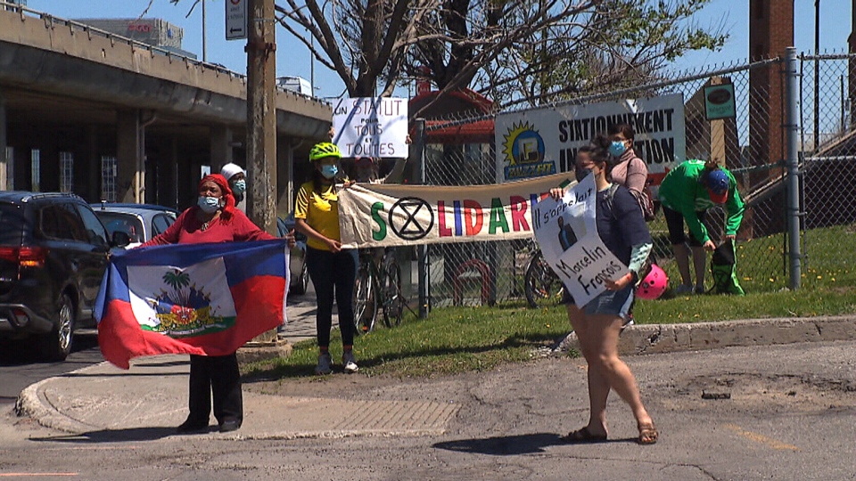 Protesters speak up outside of of the Prime Minister's constituency office in Montreal, asking for the government to do more for asylum seekers working in long-term care homes in Quebec, which are a hotbed of COVID-19.