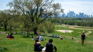 Park visitors soak up the sun in Toronto on Saturday, May 23, 2020. Warm weather and a reduction in COVID-19 restrictions has many looking to the outdoors for relief. THE CANADIAN PRESS/Frank Gunn