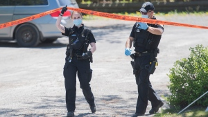 Police are shown at the scene where two bodies were discovered in the east end of Montreal, Saturday, May 23, 2020, as the COVID-19 pandemic continues in Canada and around the world. THE CANADIAN PRESS/Graham Hughes