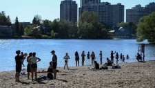 People enjoy the warm weather at Mooney's Bay Park in Ottawa, on Saturday, May 23, 2020, in the midst of the COVID-19 pandemic. THE CANADIAN PRESS/Justin Tang