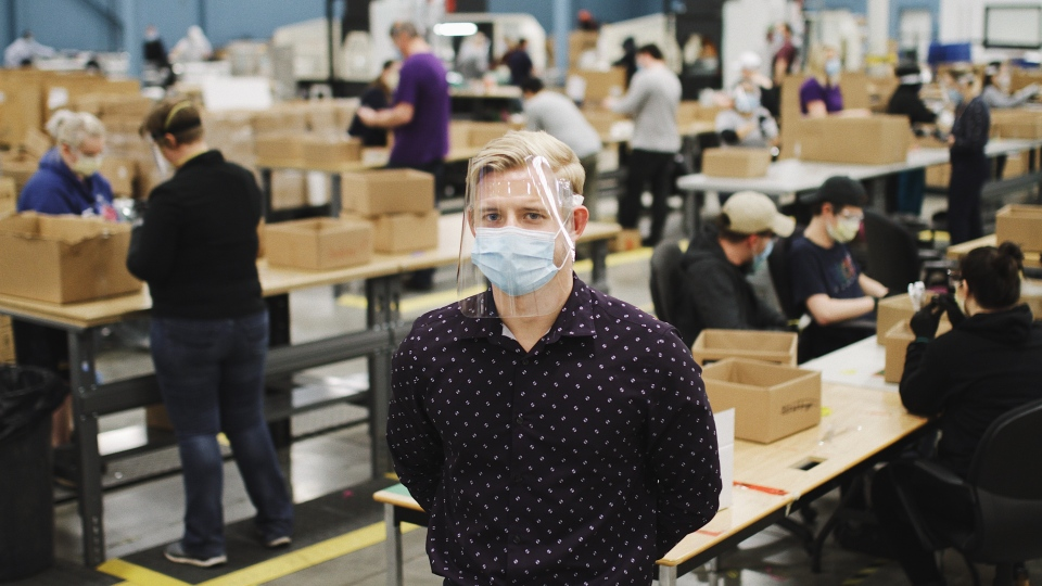 Jeremy Hedges, founder oand CEO of InkSmith and its spin-off Canadian Shield, poses for a photo on the floor of his company's new factory in Waterloo, Ont. in this undated handout photo. InkSmith is scrambling to fulfill a contract with the federal government for 10 million units. Two million more face shields are bound for hospitals and health authorities in Ontario. THE CANADIAN PRESS/HO, Canadian Shield