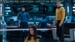 "This image released by CBS All Access shows, from left, Ethan Peck as Spock, Rebecca Romijn as Number One, and Anson Mount as Captain Pike of the the CBS All Access series ""Star Trek: Strange New Worlds."" (Michael Gibson/CBS via AP)"