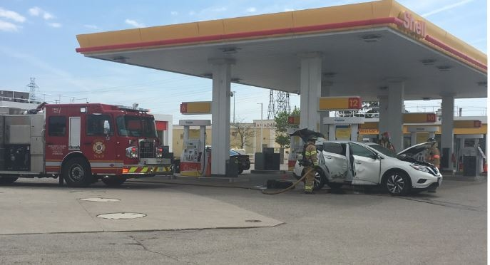 Firefighters put out an SUV on fire on Wellington Road in London Ont. on May 24, 2020. (Brent Lale/CTV London)