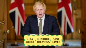 In this photo issued by 10 Downing Street, Britain's Prime Minister Boris Johnson speaks during a media briefing on coronavirus in Downing Street, London, Sunday May 24, 2020. Boris Johnson says he won't fire his chief aide Dominic Cummings for allegedly violating the national coronavirus lockdown rules that he helped to create. (Andrew Parsons/10 Downing Street via AP)