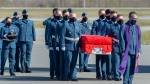 Pall bearers carry the casket of RCAF Capt. Jennifer Casey during a homecoming ceremony at Halifax Stanfield International Airport in Enfield, N.S. on Sunday, May 24, 2020.  (THE CANADIAN PRESS/Andrew Vaughan)