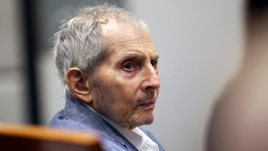 In this March 10, 2020, file photo, real estate heir Robert Durst looks over during his murder trial in Los Angeles. Attorneys for Durst have asked a Los Angeles judge to declare a mistrial in the case that was put on hold mid-trial because of coronavirus closures. Durst's team filed a motion Thursday, April 30, 2020, saying the pause in the trial that will last months even in the best-case scenario makes it impossible for the jury to do its job. (AP Photo/Alex Gallardo, Pool, File)