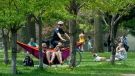 A bicycle police officer patrols Trinity Bellwoods Park in Toronto on Sunday, May 24, 2020. Warm weather and a reduction in COVID-19 restrictions has many looking to the outdoors for relief. THE CANADIAN PRESS/Frank Gunn