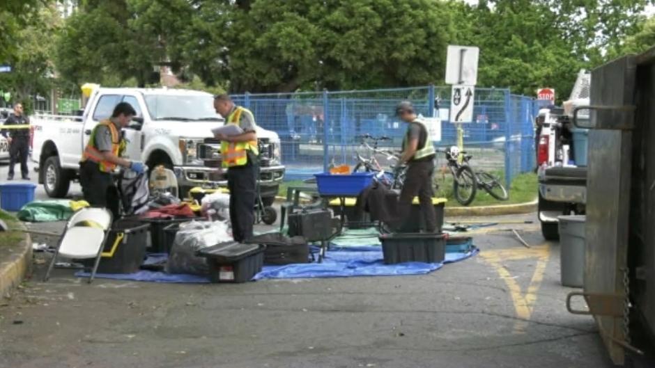 Crews work to clean up Pandora Avenue Sunday. (CTV)