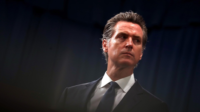 California Gov. Gavin Newsom looks on during a news conference with California attorney General Xavier Becerra at the California State Capitol on August 16, 2019 in Sacramento, California. (Photo by Justin Sullivan/Getty Images)
