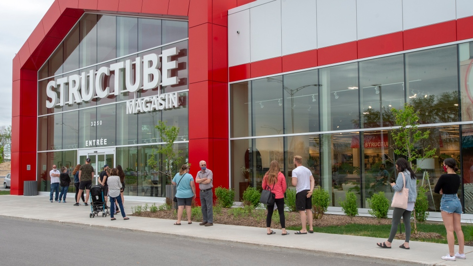 Customers line up at a Structube