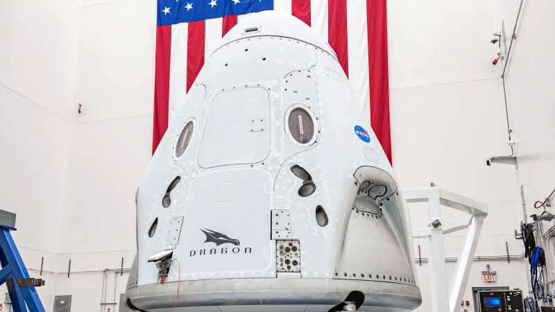 This April 2020 photo made available by SpaceX shows the company's Crew Dragon spacecraft undergoing final processing at Cape Canaveral Air Force Station, Fla,, in preparation for the May 27, 2020, Demo-2 launch with NASA astronauts Bob Behnken and Doug Hurley to the International Space Station for NASA's Commercial Crew Program. (SpaceX via AP)