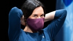 Montreal Mayor Valerie Plante slips on her protective mask during a news conference in Montreal, on Thursday, May 14, 2020. THE CANADIAN PRESS/Paul Chiasson