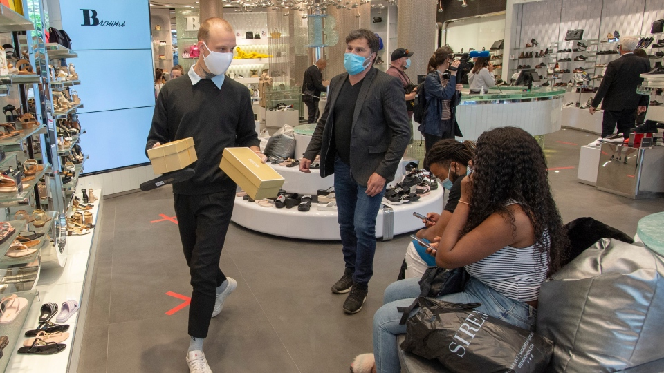 Customers shop for shoes at Brown's shoe store