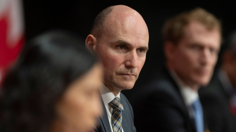 President of the Treasury Board Jean-Yves Duclos looks on as Canada's Chief Public Health Officer Theresa Tam delivers her opening remarks at a daily news conference in Ottawa, Thursday, May 21, 2020. THE CANADIAN PRESS/Adrian Wyld