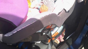 Caledon OPP says this two-year-old child was not strapped into her car seat and the seat itself was not properly secured. (OPP/Twitter)