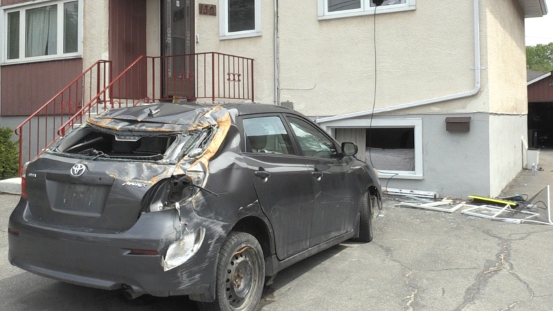 Police say the beat up car in the driveway of Sunday's standoff is unrelated to the incident. May 25/20 (Molly Frommer/CTV Northern Ontario)