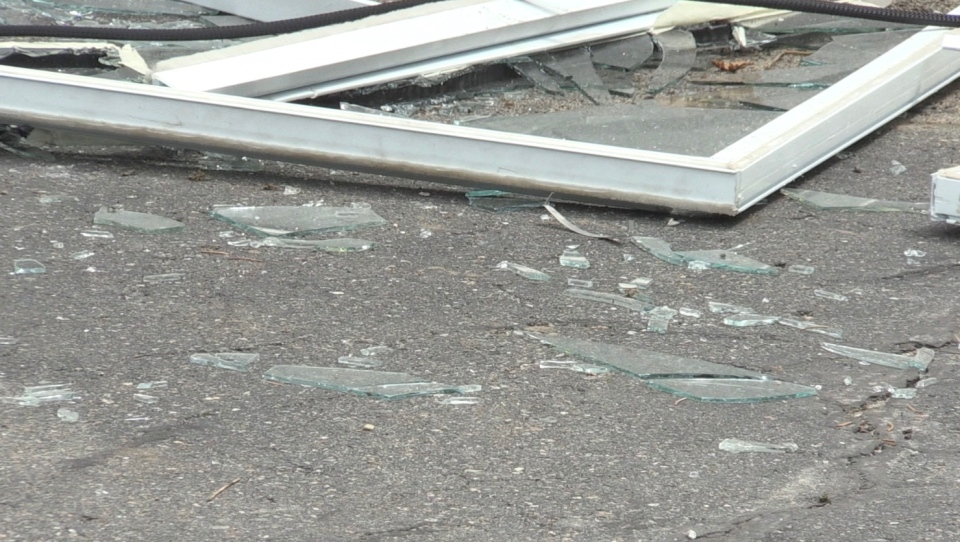 Broken window on the ground at the scene of a 20-hour standoff with police at a home on Christakos Street. May 25/20 (Molly Frommer/CTV Northern Ontario)