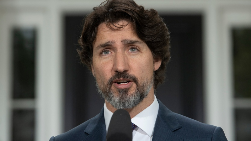 Prime Minister Justin Trudeau delivers his opening remarks at the start of a news conference outside Rideau Cottage in Ottawa, Monday May 25, 2020. THE CANADIAN PRESS/Adrian Wyld