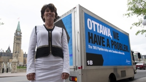 File photo: Energy Minister Sonya Savage poses in front of the Parliament Buildings in Ottawa on May 29, 2019. Alberta's energy minister says it's a good time to build a pipeline because public health restrictions limit protests against them. Sonya Savage made the comment Friday in a podcast hosted by the Canadian Association of Oilwell Drilling Contractors. THE CANADIAN PRESS/Adrian Wyld